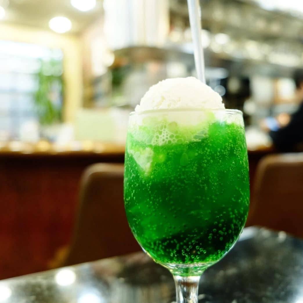 Bright green melon soda float, a popular drink at kissaten (retro coffee shops). At Daiwa in Fukushima, Osaka.